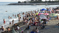 Crowd in mediterranean beach a afternoon summer Stock Footage