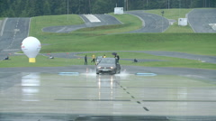 The demonstration of driving on wet court Stock Footage