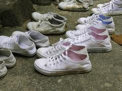 Many pairs of white sneaker Stock Photos