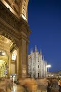 nigt at Piazza del Duomo in Milan, Italy, with Duomo right  and Galleria Vitt - stock photo