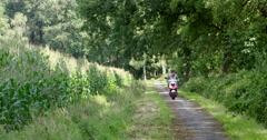 Senior man on a moped in nature 4K - stock footage