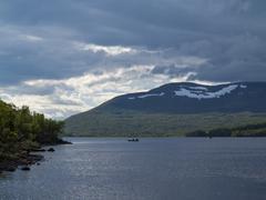 fishing on the lake Kroktjarnen Sweden Harjedalen area - stock photo
