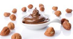 Sweet chocolate spread with whole hazelnut Stock Photos