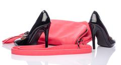 Pink handbag and black high heel shoes - stock photo