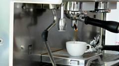 Coffee machine filling a cup with hot fresh coffee Stock Footage