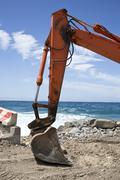 Stock Photo of Excavator on the beach