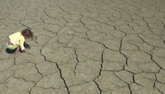 Child Walks Barefoot On Cracked Dry Ground Stock Footage