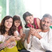 Beautiful Indian family - stock photo