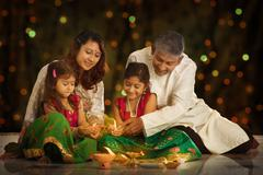Indian family celebrating Diwali, fesitval of lights - stock photo