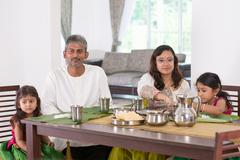 Indian family dining at home - stock photo