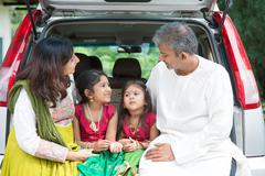 Indian family going to vacation - stock photo