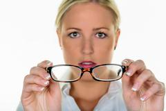 Woman holding a pair of glasses Stock Photos