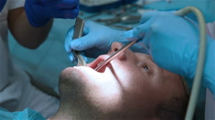 Dentist sutures gum Stock Footage