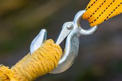 Steel hook and yellow rope and strap Stock Photos