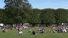 People enjoying Rosenborg Castle Gardens - Copenhagen Denmark Stock Footage