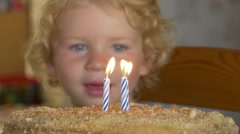 Three Year Old Boy Blowing Off The Candles Stock Footage
