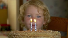 Cute Kid Blowing Out A Birthday Candle - stock footage