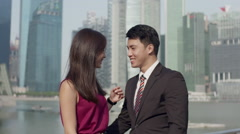 Asian couple turning to camera, smile Stock Footage
