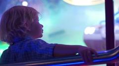 Child Having Fun On Amusement Park Stock Footage