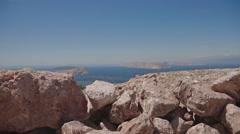 Landscape rock mountain in Croatia slide front of the sea Stock Footage