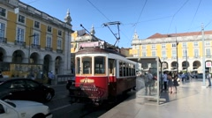 Old tramway passing by the Comercio place, Lisbon - stock footage