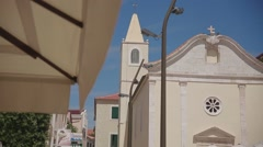 Small village church at summer holiday Stock Footage