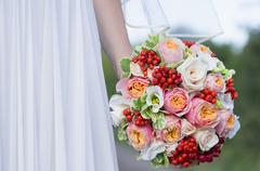 Beautiful colorful wedding bouquet in a hand of a bride Stock Photos