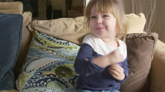 Cute toddler girl smiling and making faces Stock Footage