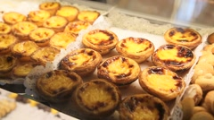 Pasteis de nata, typical pastries of Lisbon, Portugal Stock Footage