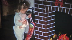 BOULDER, COLORADO 1951: Girl opens Christmas stocking gets candy out. - stock footage