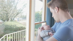 Father bonding with newborn son - stock footage