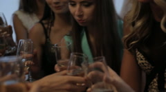 Dressed girls drinking champagne at a banquet Stock Footage