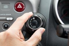 Man turning car air conditioner switch Stock Photos