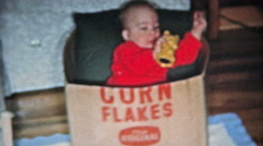 BOULDER, COLORADO 1951: Baby playing in Kelloggs Corn Flakes box. Stock Footage
