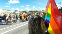 Rainbow flag near and close Gay pride parade in Stockholm Stock Footage