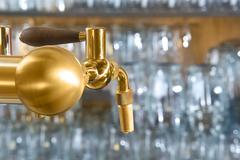 Beer tap detail with handle amde from gold metal Stock Photos