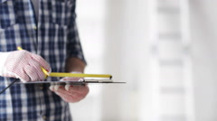 Close up of man with measuring ruler and clipboard Stock Footage