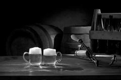 Beer still life on the table with old keg of beer and tap Stock Photos