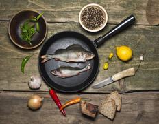 Perch fish on the cast iron pan Stock Photos