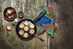 potato pancaces on the cast iron pan - stock photo