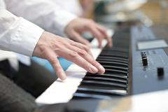 Player pianist fingers on keyboard close up Stock Photos