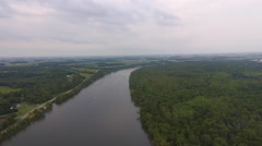 High aerial view of bend in river and green trees Stock Footage