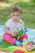 Baby, less than a year old   playing with  toy Stock Photos