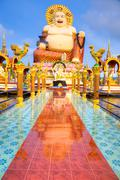 Stock Photo of Smiling Buddha of wealth statue