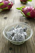 Dragon Fruit in the bowl on the wooden table, Selective focus. Stock Photos