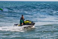 Man on jet ski with high speed and adrenalin. Stock Photos