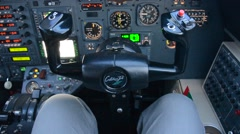 Pilot in an airplane cockpit, airplane instruments Stock Footage