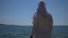 Muslim woman at beach on Hvar island Stock Footage