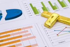 Gold Bullion on business report - stock photo