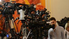 Journalists waiting in press center press conference - stock footage
